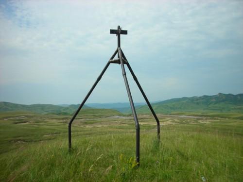 The three-legged cross near the mud volcanoes (we visited) in Romania.
